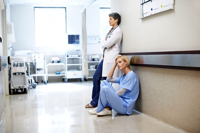 Sad doctors in hospital corridor