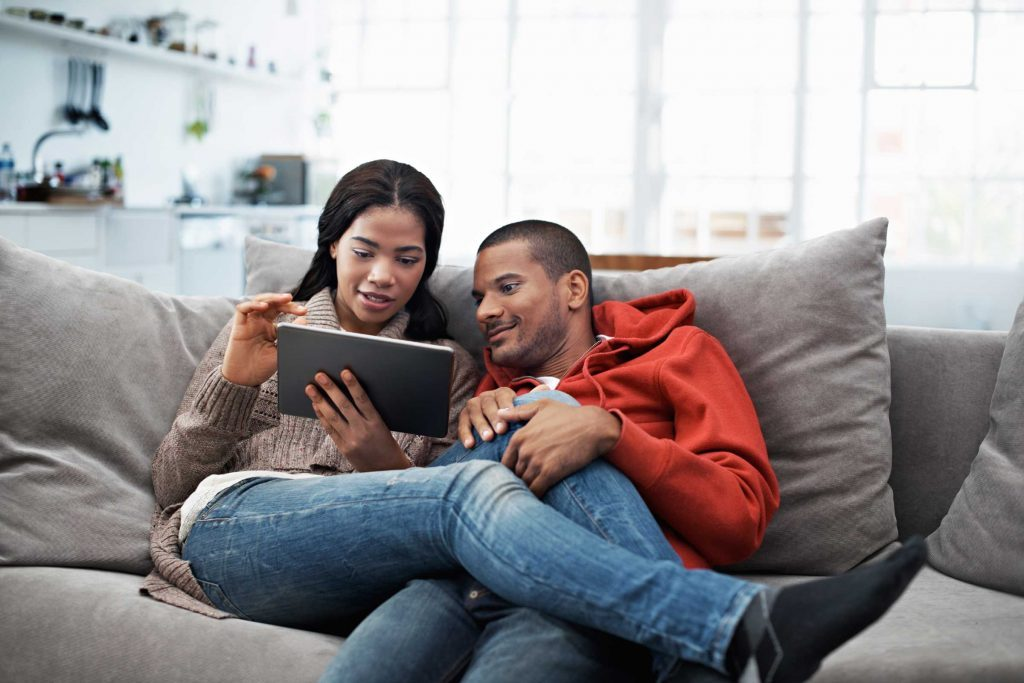 couple on couch with ipad