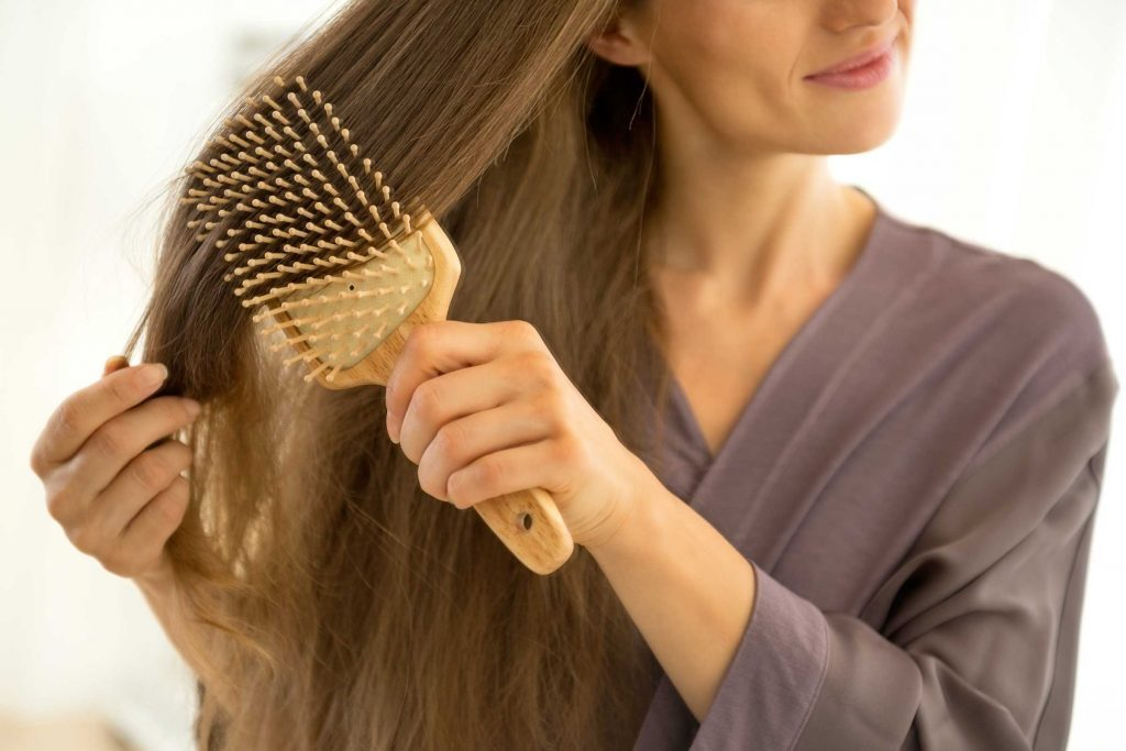 Women brushing her long hair.
