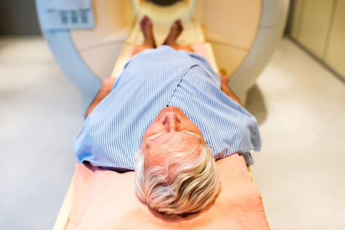 patient going into body scan machine
