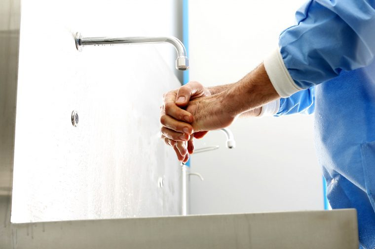 healthcare worker washes hands