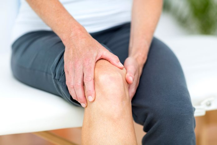 sitting person holding knee