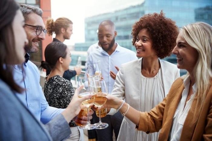 group drinking wine at social event