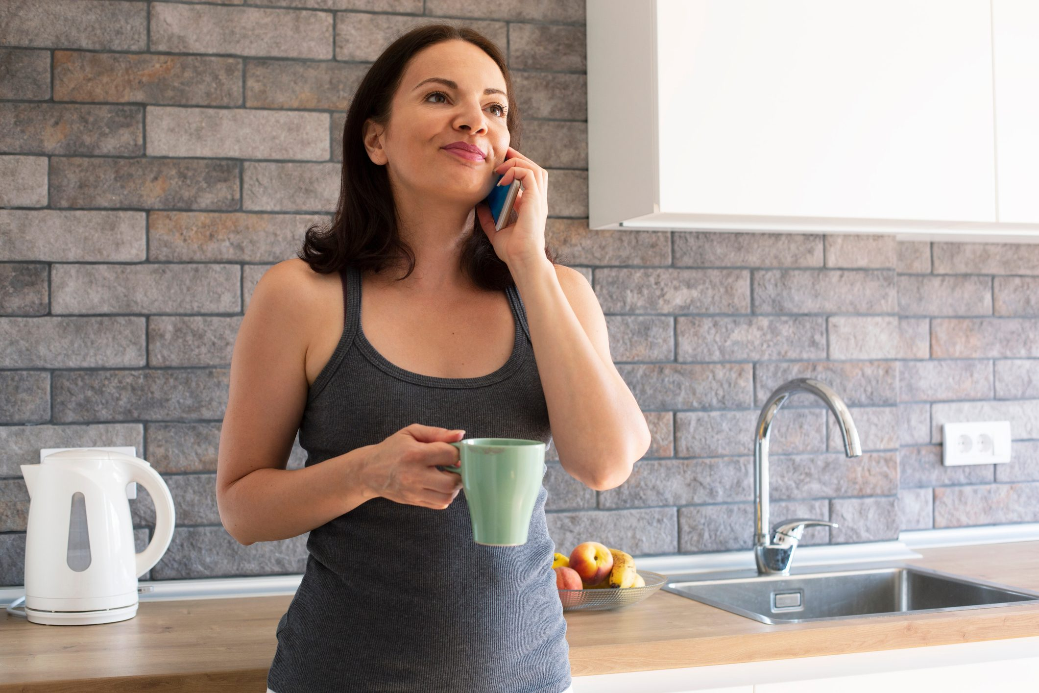 woman talking on the phone in kitchen