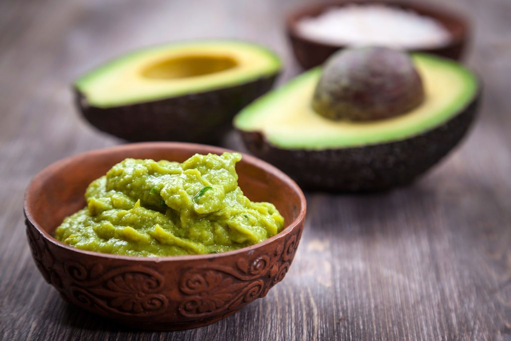 bowl of guacamole, avocado, and salt
