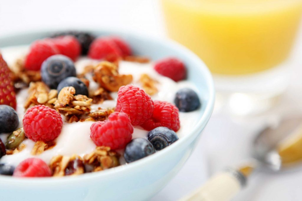 Yogurt bowl with berries and granola.