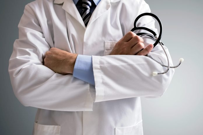 doctor with arms folded, with stethoscope