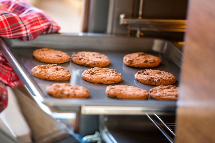 tray of chocolate chip cookies coming from the oven
