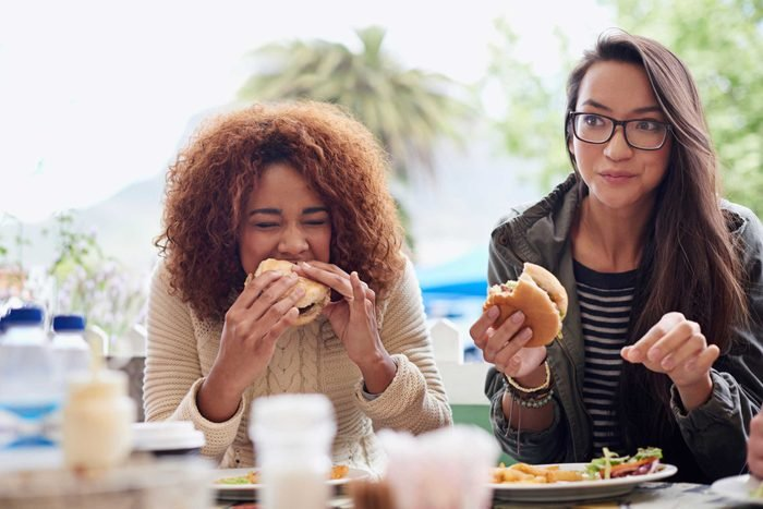 Women eating a meal.