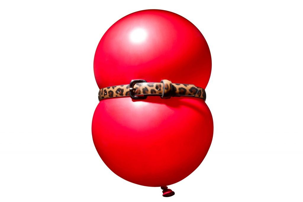 red ballon with a cinched leopard-print belt around the center