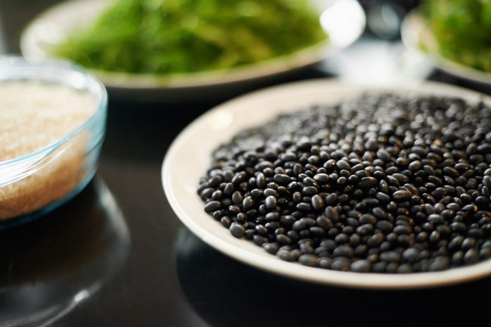 bowls of black beans, brown rice, and greens