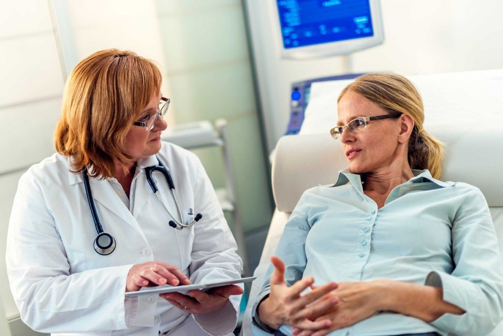 female doctor discussing diagnosis with female patient