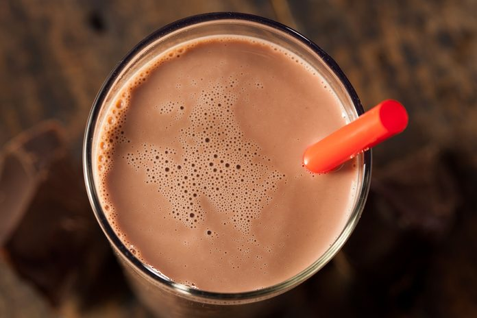 glass of chocolate milk with red straw