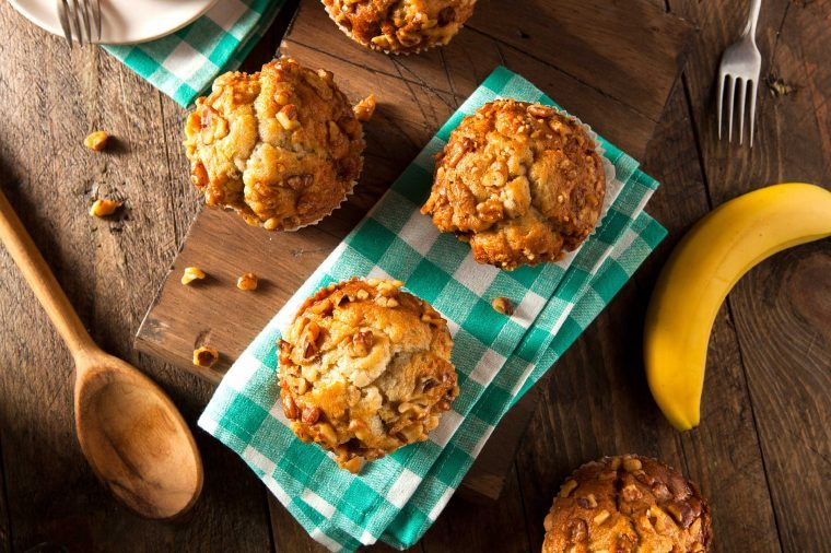Carb-heavy muffins on a green plaid napkin on a wooden table.