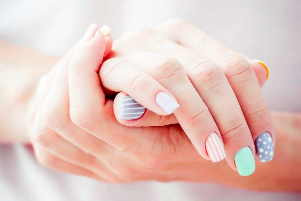 woman with extravagant manicured nails