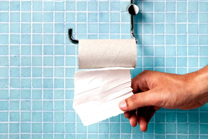 Someone pulling the last square of toilet paper off the roll.