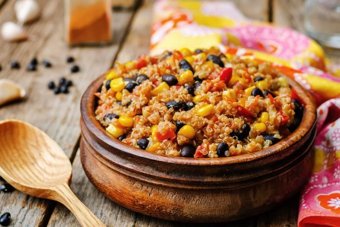 bowl of quinoa with corn, tomatoes, and black beans