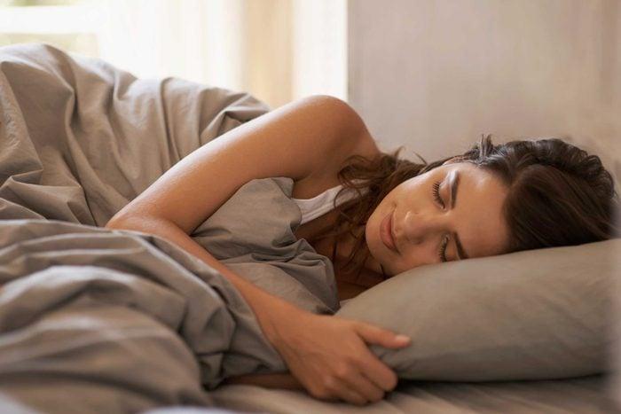 Woman asleep in bed.