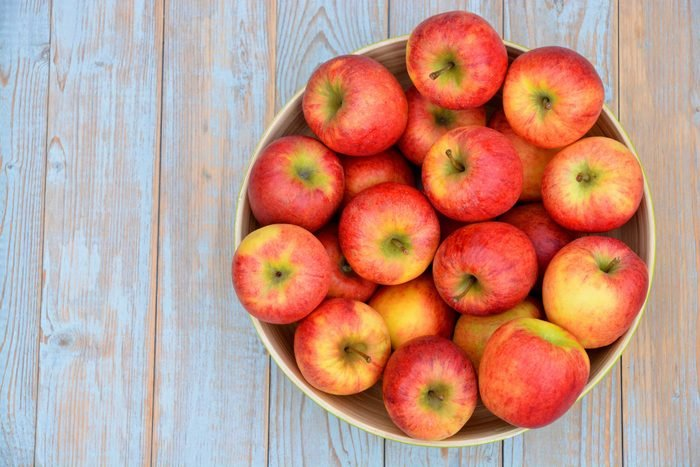 A top view of a bowl of red apples.