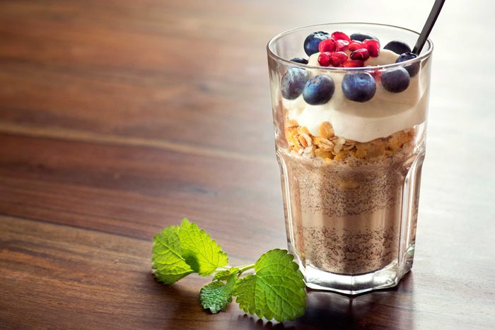 Fiber-rich smoothie topped with oats, yogurt, and berries.