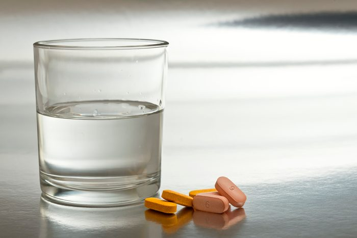 glass of water and medication