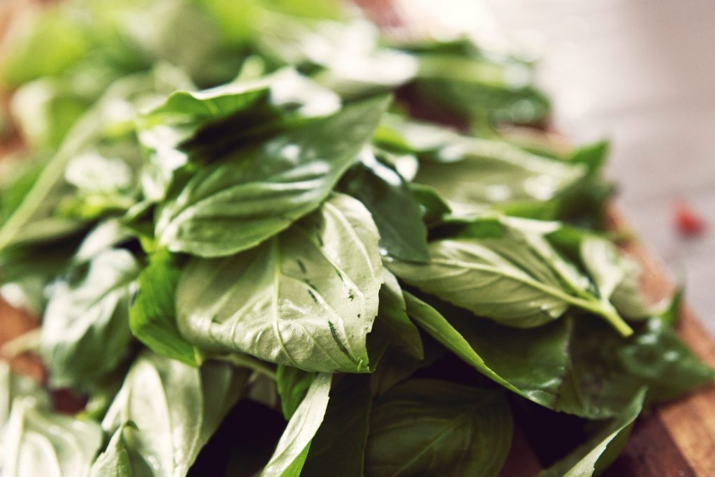 basil leaves on cutting board