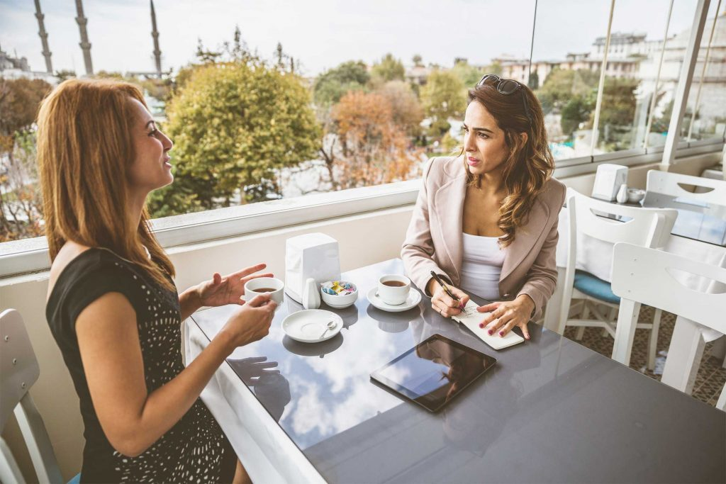 Women talking over coffee at a restaurant