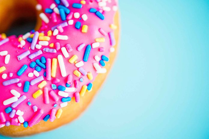 donut with pink frosting and sprinkles