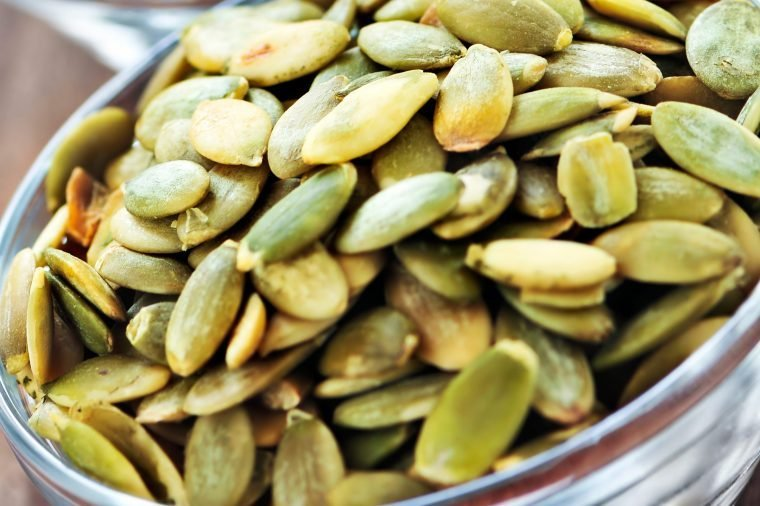 Bowl of pumpkin seeds.
