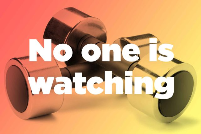 """Words """"no one is watching"""" over hand weights"""
