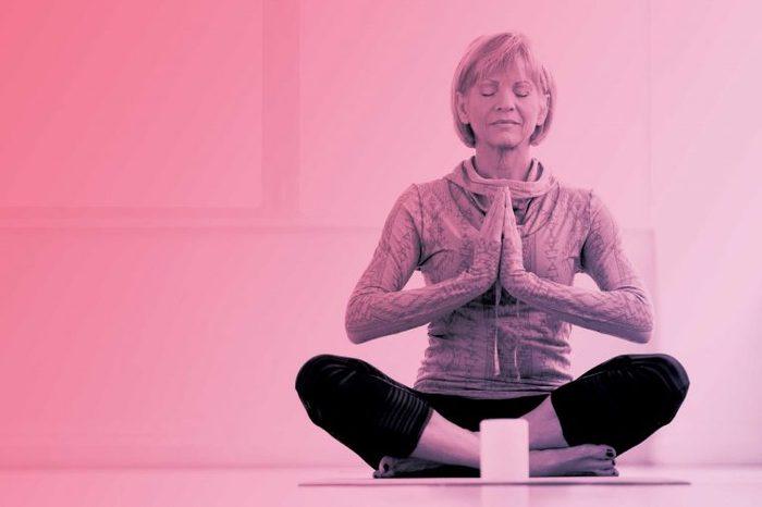 woman meditating in prayer yoga pose