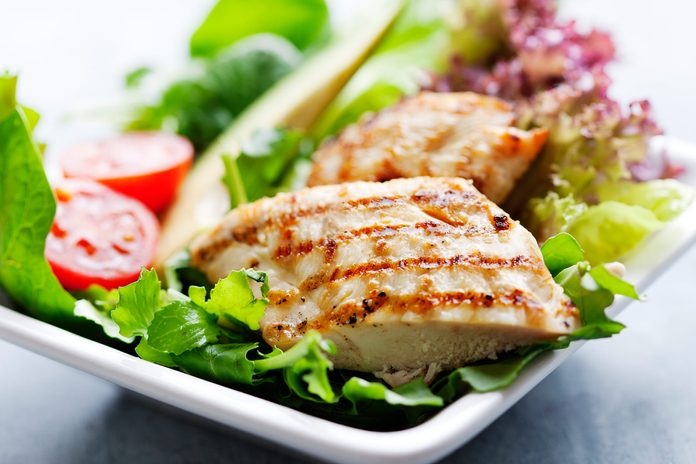 Grilled chicken on a salad.