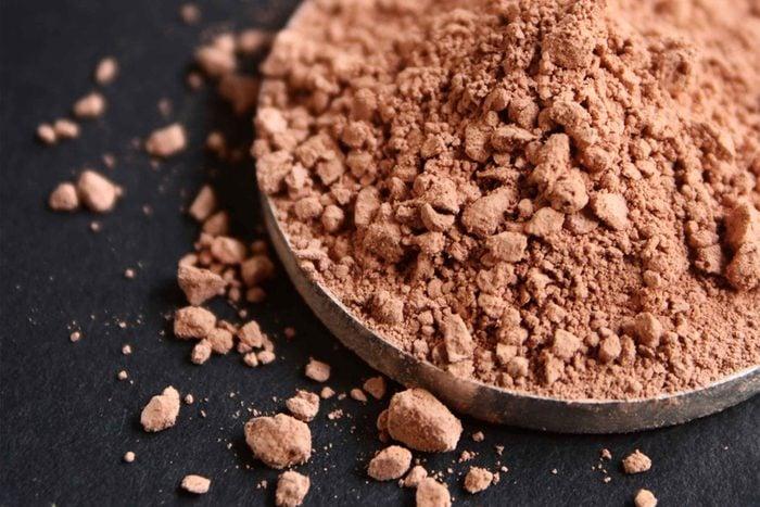 Tin of bronzer makeup powder.