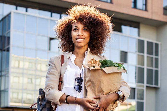 black woman carrying groceries