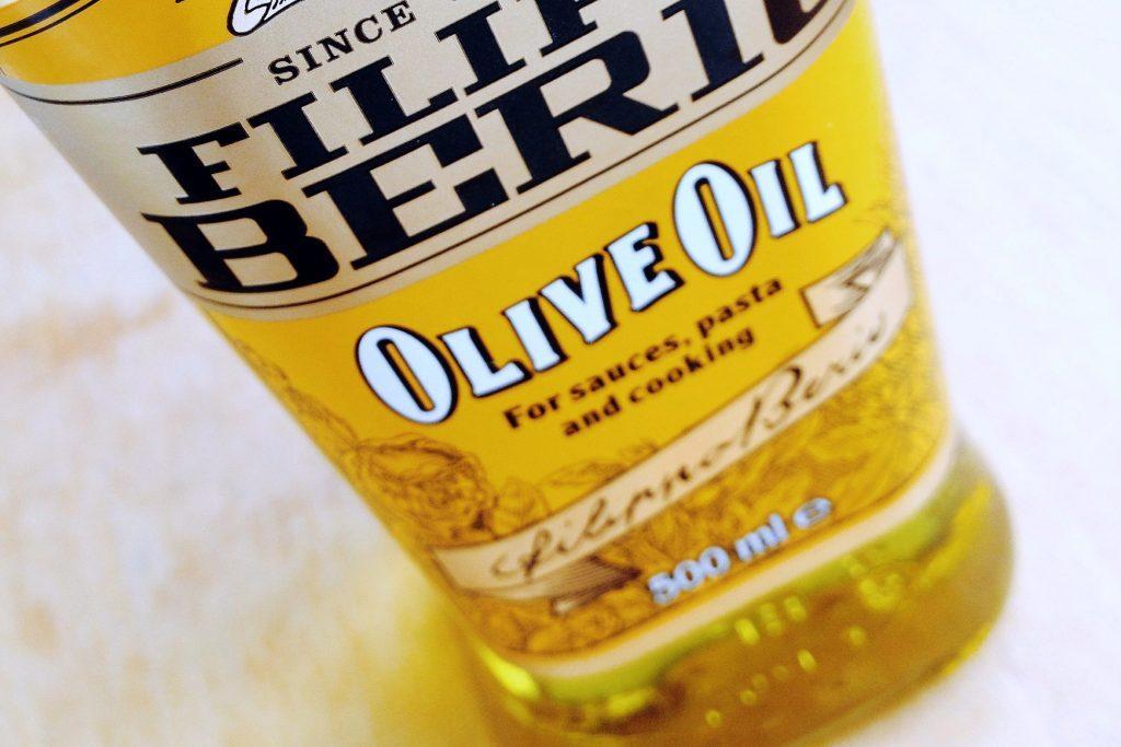 close up of olive oil bottle label