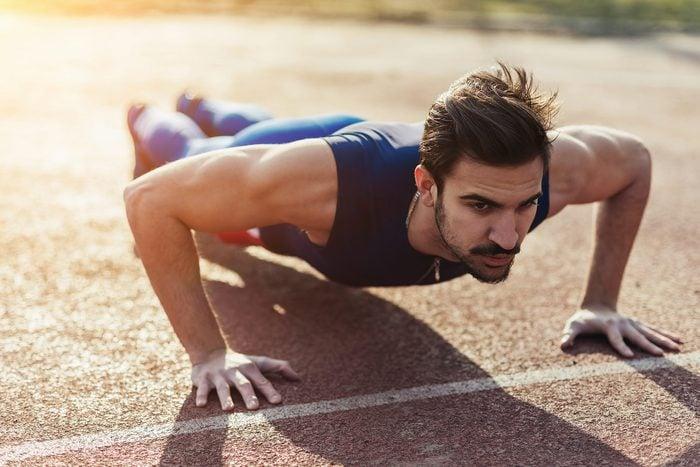 man outdoors doing pushups