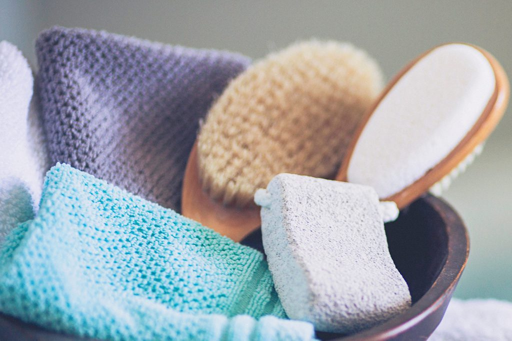 basket with brushes, pumice, and washcloths