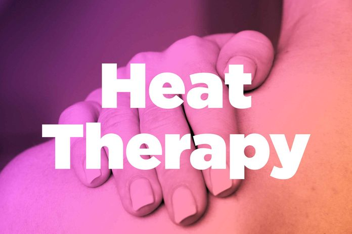 "Words ""heat therapy"" over image of hands rubbing shoulder"