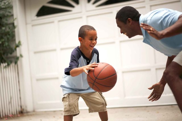 father and son playing basketball