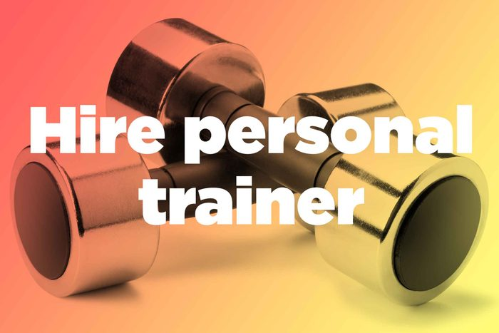 """Words """"hire personal trainer"""" over hand weights"""