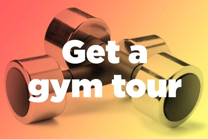 """Words """"get a gym tour"""" over hand weights"""