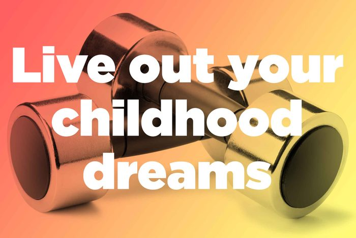 """Words """"live out your childhood dreams"""" over hand weights"""