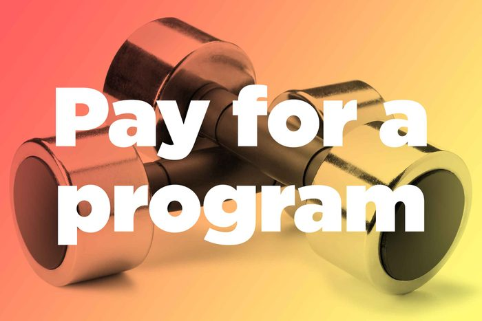 """Words """"pay for a program"""" over hand weights"""