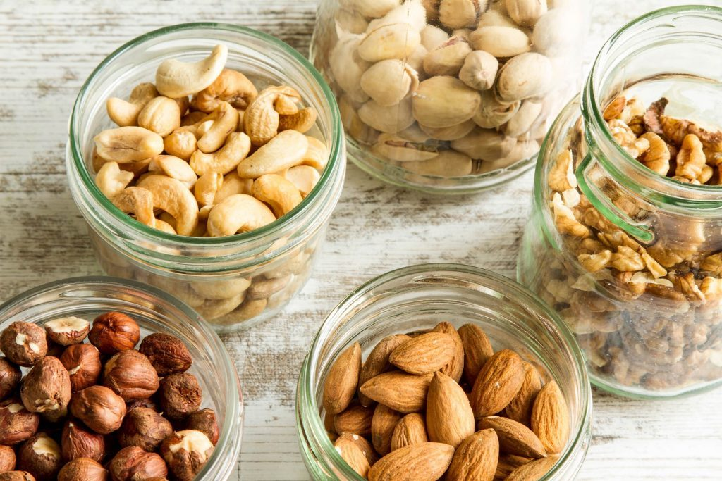 various types of nuts in glass jars