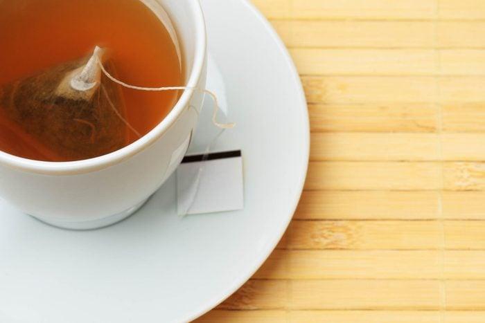 tea bag steeping in a white tea cup