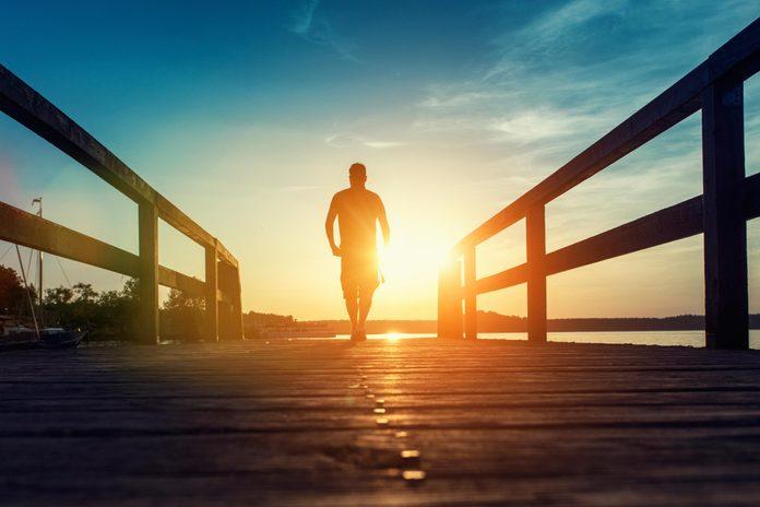 Person walking at sunset