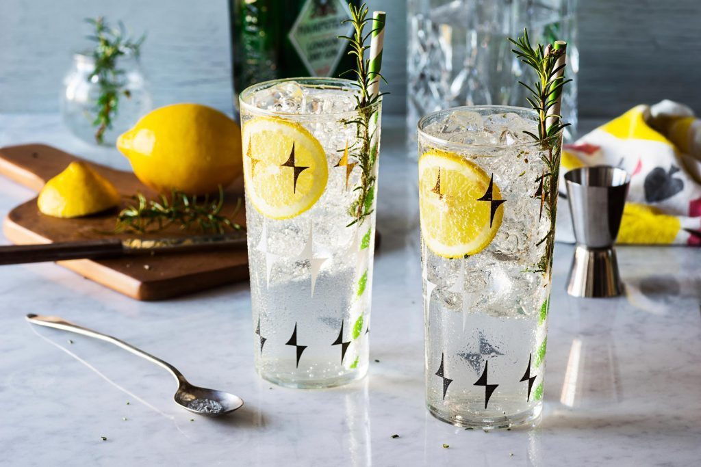 Glass of water with lemon and rosemary