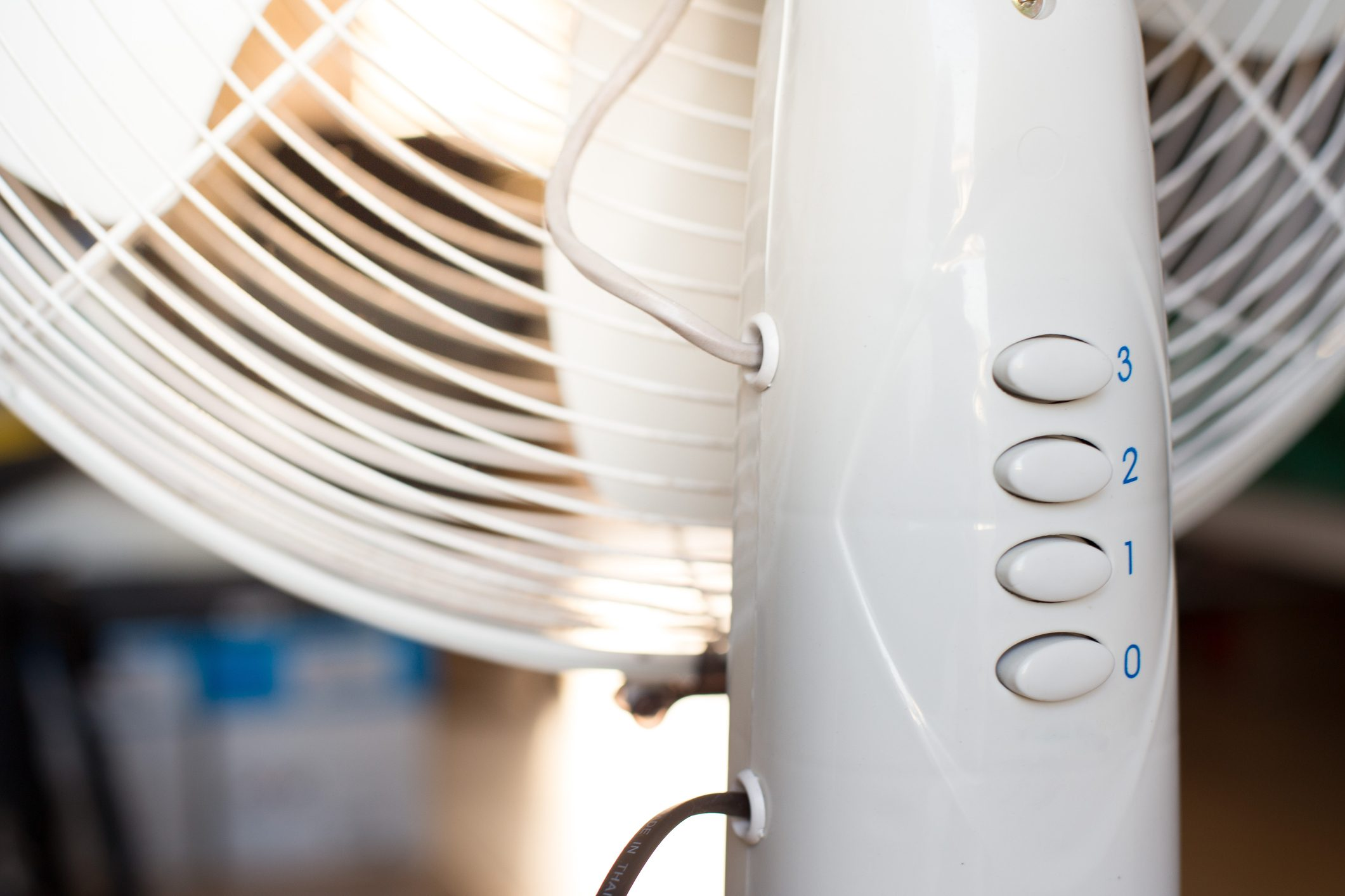 close up of standing fan in home