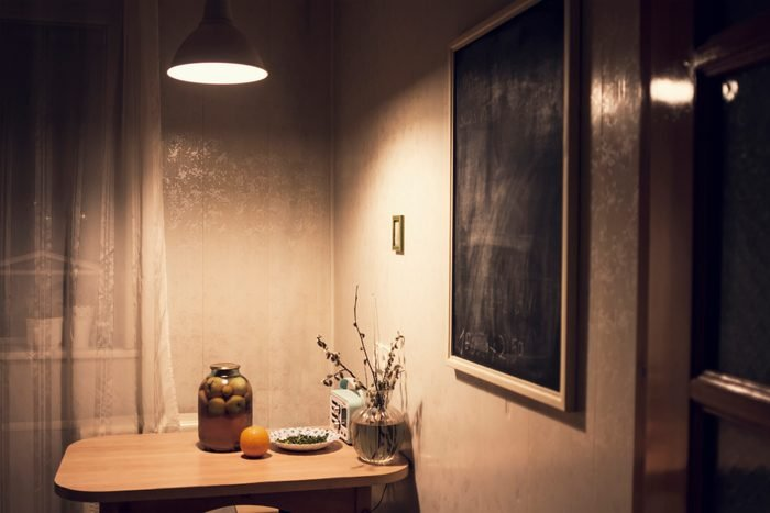 light over kitchen table shining at night
