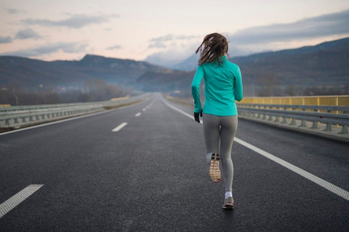 rear view of a woman on a long distance run